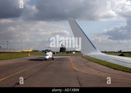 Plane during starting aproach on Okecie airport in Warsaw, view from airplane window - Stock Photo