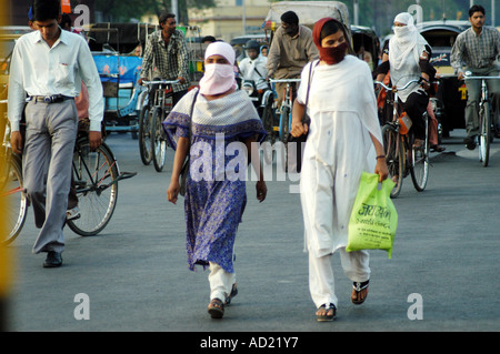 ASB73139 Two women cover their faces with scarf to avoid heat during the summer season at Nagpur city Maharashtra - Stock Photo