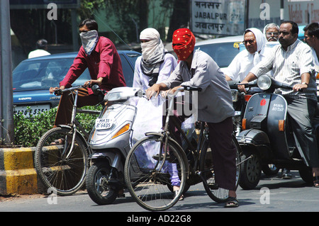 ASB73154 Two wheeler motor bike riders cover their faces with scarfs to avoid summer heat at Nagpur Maharashtra - Stock Photo