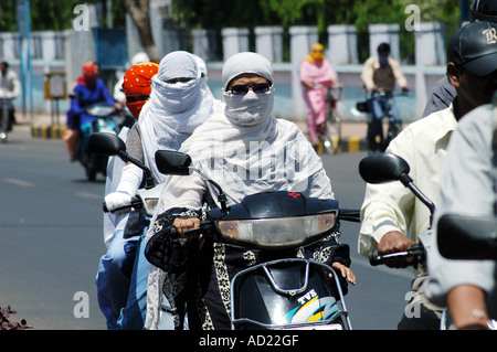 ASB73160 Two wheeler motor bike riders cover their faces with scarfs to avoid summer heat at Nagpur Maharashtra - Stock Photo