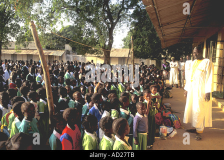 Christian assembly with pupils and headmaster at a Methodist primary school in Ghana, West Africa - Stock Photo