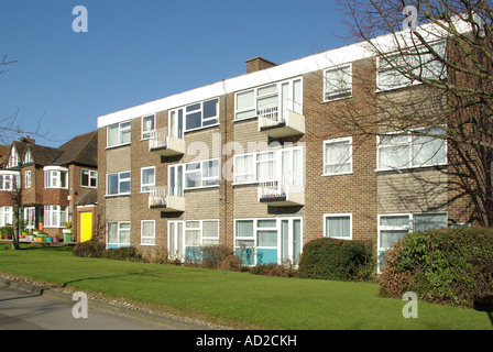 Typical small block of flats in suburbia - Stock Photo