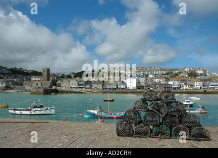 lobster nets stacked on the quay at St Ives in Cornwall, UK - Stock Photo