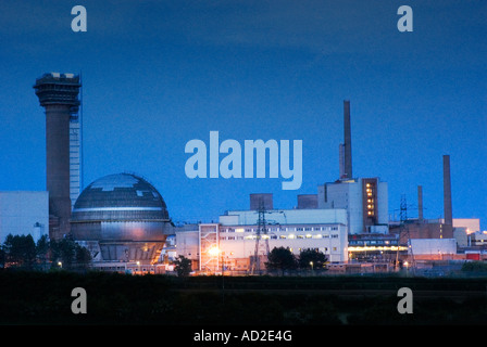 Sellafield nuclear reprocessing plant at night showing the Windscale reactor - Stock Photo
