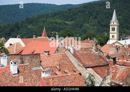 View of Sighisoara and Roman Catholic Church from the clock tower, Sighisoara, Transylvania, Romania - Stock Photo
