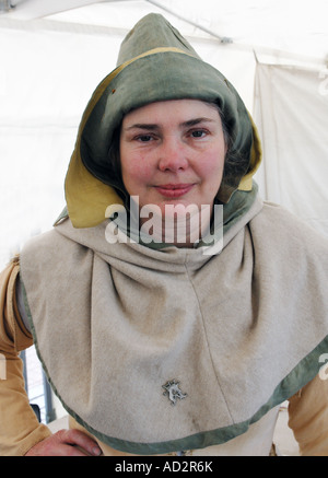Mediaeval dyer in traditional costume at a market re-enactment - Stock Photo