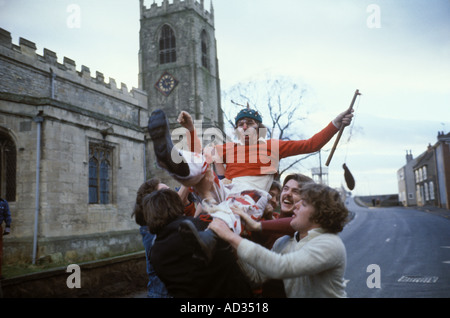 Fool is caught and carried to the Mowbray stone   where he makes a speech.  Haxey Hood Game   Haxey Lincolnshire - Stock Photo