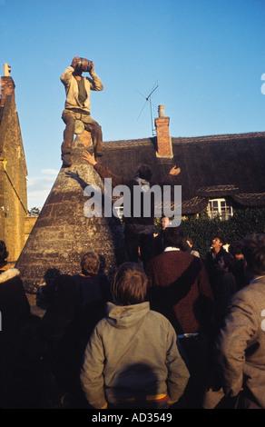 [Bottle Kicking] and [Hare Pie] Scrambling Hallaton Leicestershire UKCelebration on 'Butter Cross'. HOMER SYKES - Stock Photo