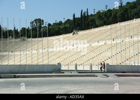 Athens couple people view Panathinaiko white marble arena & track stadium for Greek Olympic Games of 1896 now a - Stock Photo