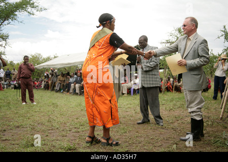 Betty Maitau receives certificate from Jake Grieves-Cook, director of Kenya Tourism Board - Stock Photo