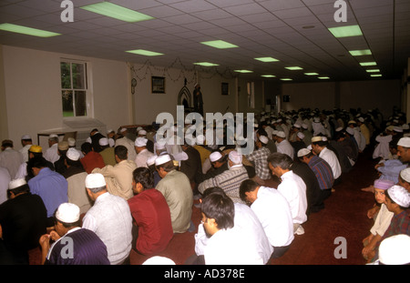 Listening to the Friday sermon at the Shah Jahan Mosque in Woking Surrey - Stock Photo