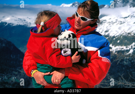 Ski instructor with young child France ESF - Stock Photo