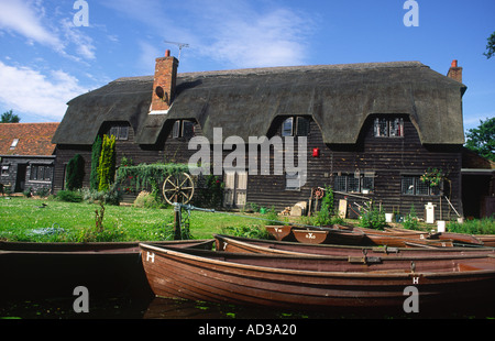 Thatched House on the River Stour near Flatford Mill Flatford Suffolk - Stock Photo