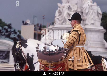 Member of Household Cavalry Mounted Regimental Band with kettle drum on Clydesdale Drum Horse, Trooping the Colour - Stock Photo