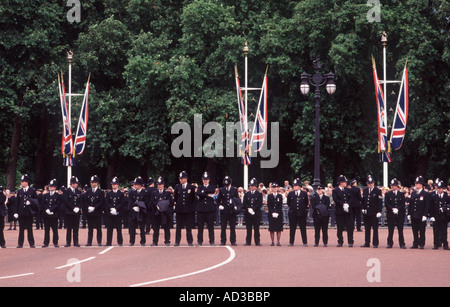 Thin Blue Line: London Metropolitan police officers forming protective line across the top of The Mall, Trooping - Stock Photo