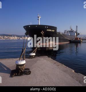 Early morning image of Petroleum Product Carrier 'AGISLAOS' discharging cargo - Port of Palma de Mallorca. - Stock Photo