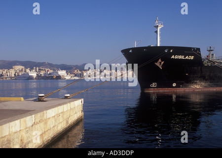Early morning image of Petroleum Product Carrier 'AGISLAOS' discharging cargo - with ferries, luxury sailing and - Stock Photo