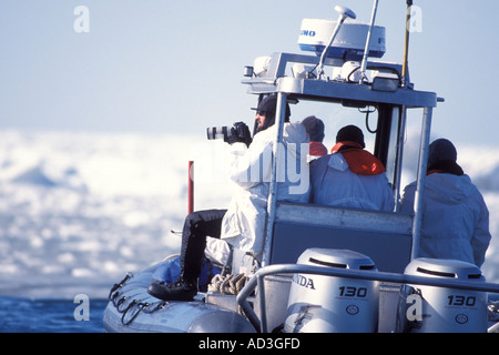 Stimson skiff in the pack ice with scientists studying walrus Bering Sea Alaska - Stock Photo
