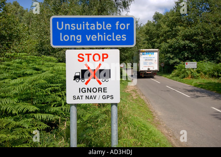 Villagers place an 'ignore Sat Nav' sign to warn lorry drivers of unsuitable route for long vehicles. Picture by - Stock Photo