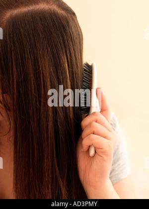 Teenage Girl Brushing Hair Close up of Hair & Brush - Stock Photo