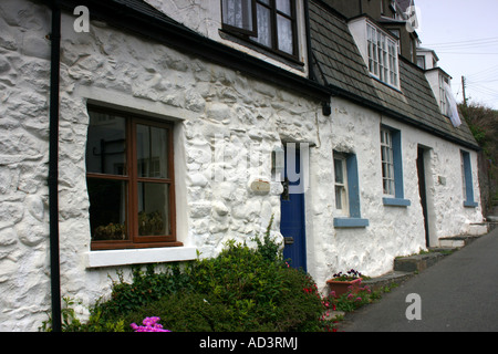 Whitewashed stone cottages in Criccieth, Lleyn Peninsula, North Wales - Stock Photo