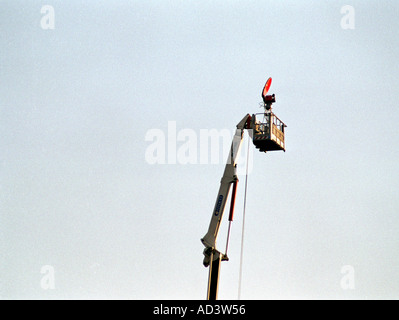 tv camera high up on top of a crane  - Stock Photo