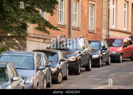 Parking row of cars in Wismar, Germany - Stock Photo