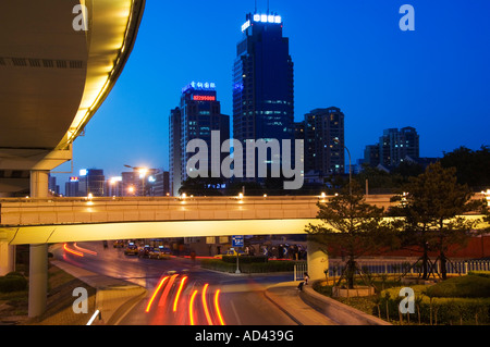car light trails and modern buildings near Beijing North Train Station Xizhimen district Beijing China