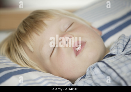 Little boy sleeping in his bed, close-up - Stock Photo