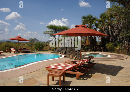 Sunloungers at the pool, Larwsens Camp, Samburu, Kenya, Africa - Stock Photo