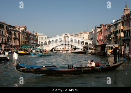 Rialto-Bridge at the Canal Grande, Venice Italy. In front a Gondola - Stock Photo