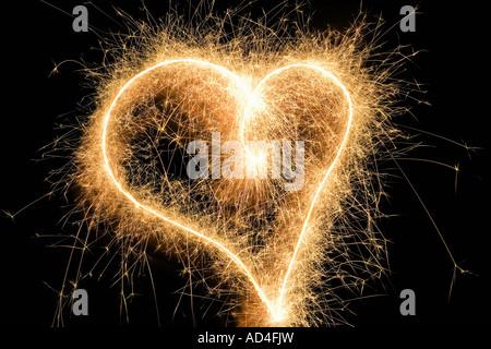 A heart shape drawn with a sparkler