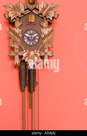 A cuckoo clock on a wall - Stock Photo