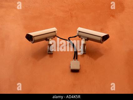 Surveillance cameras on a wall - Stock Photo