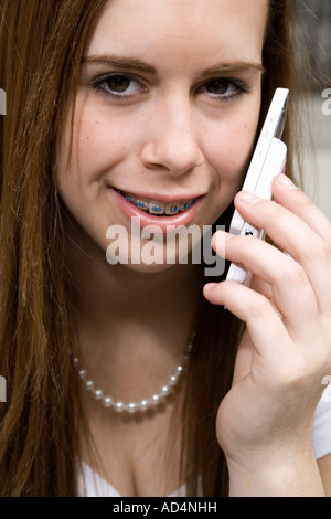An adolescent girl using a mobile phone - Stock Photo