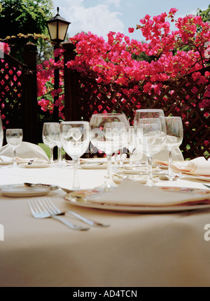 Place settings at a hotel restaurant - Stock Photo
