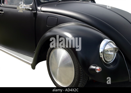 cut out of matt black VW beetle against white background - Stock Photo