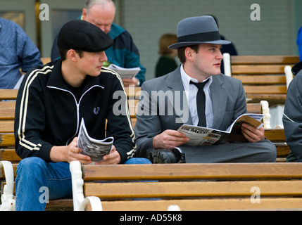 Horse Racing Fans Studying Track Line-up - Stock Photo