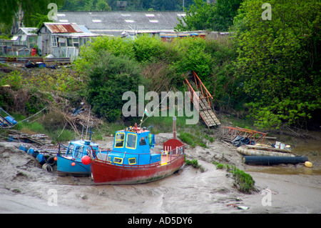 Inshore leisure fishing boats moored in mud on banks of the tidal River Usk at Newport South Wales UK - Stock Photo