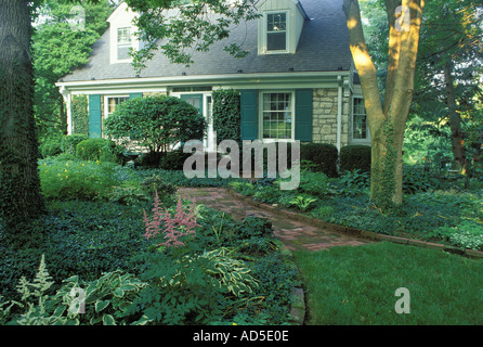 Stone cottage surrounded by flowers in a rural english for Cape cod stone and gravel