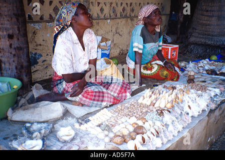 Local women selling marine souvenirs shells and corals Inhaca Island Maputo Mozambique southern Africa - Stock Photo
