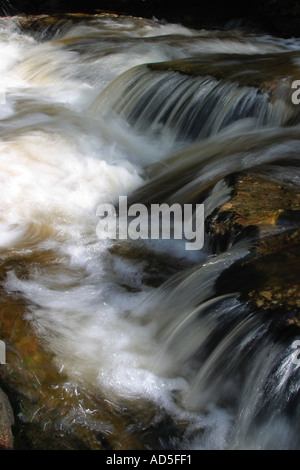 Upper river Eden in spate after rain storm - Stock Photo