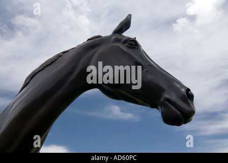 Bronze statue of ten year old racehorse Best Mate winner of three Gold Cups at the Cheltenham Races National - Stock Photo