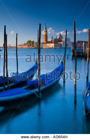 Gondolas moored on the water with the Cathedral of San Giorgio Maggiore behind, Venice, Italy - Stock Photo