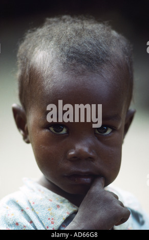 PICTURE CREDIT DOUG BLANE African child with his finger in his mouth - Stock Photo