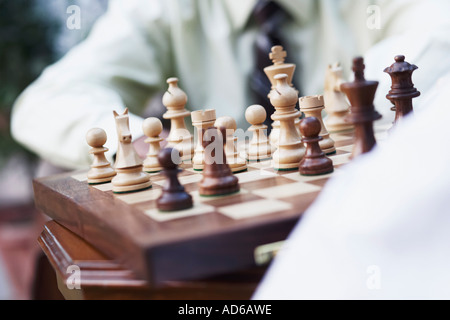 Mid section view of two businessmen playing chess - Stock Photo