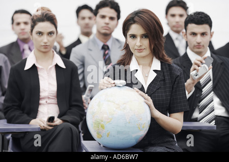 Portrait of business executives sitting in a meeting - Stock Photo