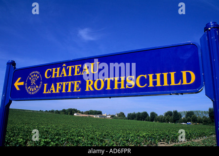 France Bordeaux Region Sign leading to the estate of Chateau Lafite Rothschild. Vineyard background. - Stock Photo