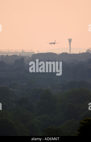 Commercial aeroplane coming to land at London Heathrow Airport view from Richmond Park - Stock Photo