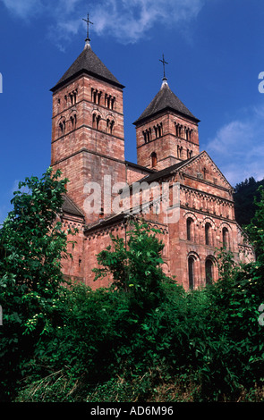 Romanesque church of Murbach —dating from 10c — rising from green valley above Buhl, Haut Rhin, Alsace, France - Stock Photo